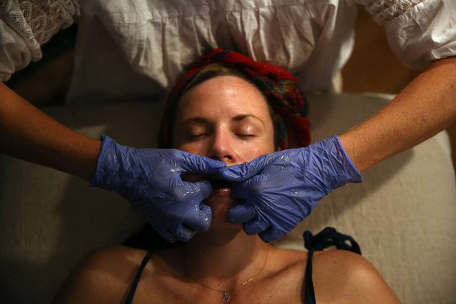 Holey spent two years in France learning the Buccal technique, an inner-mouth massage. Photo: Liz Hafalia, The Chronicle