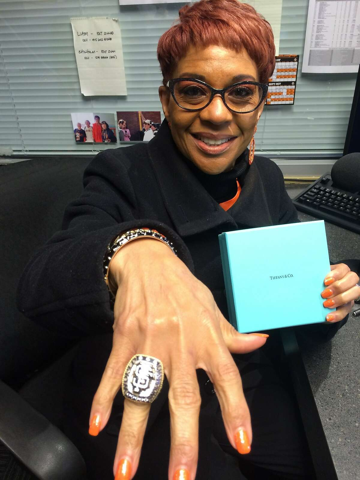 Renel Brooks-Moon, the Giants announcer, shows off her World Series ring.