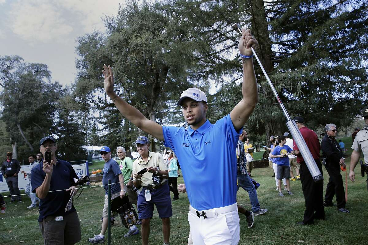 The Warriors' Stephen Curry makes his way through the gallery on the way to the 8th tee, during the Fry's.com Pro-Am a day before the start of the tournament in Napa, Calif., on Wed. October 14, 2015.