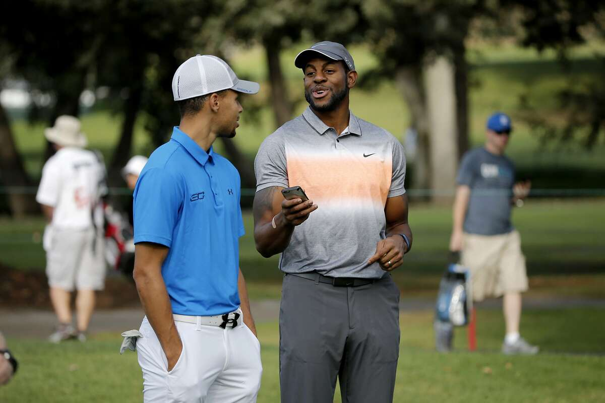 Warriors' Stephen Curry and Andre Iguodala share a laugh on the 8th green during the Fry's.com Pro-Am at Silverado Resort in Napa, Calif., on Wed. October 14, 2015.