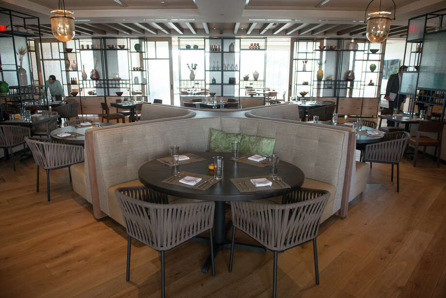 The blend of warm wood floors and metal-accented furniture gives a stylish and relaxed feel to the interior of SweetFire Kitchen. Photo: Robin Jerstad /San Antonio Express-News