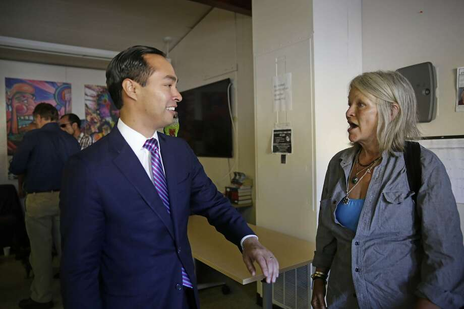 Housing and Urban Development Secretary  Julian Castro (left) talks with Mellody Gannon (right), San Francisco Navigation Center client, as her bird Hugzs sits on his  shoulder  as he tours the San Francisco Navigation Center on Wednesday, October 14,  2015 in San Francisco, Calif. Photo: Lea Suzuki, The Chronicle