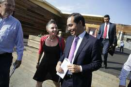 Housing and Urban Development Secretary  Julian Castro (left) talks with Laura Guzman (center),  director Mission Neighborhood Resource Center and Bevan Dufty, the director of Housing, Opportunity, Partnerships and Engagement (left), at the end of a tour of the San Francisco Navigation Center on Wednesday, October 14,  2015 in San Francisco, Calif.