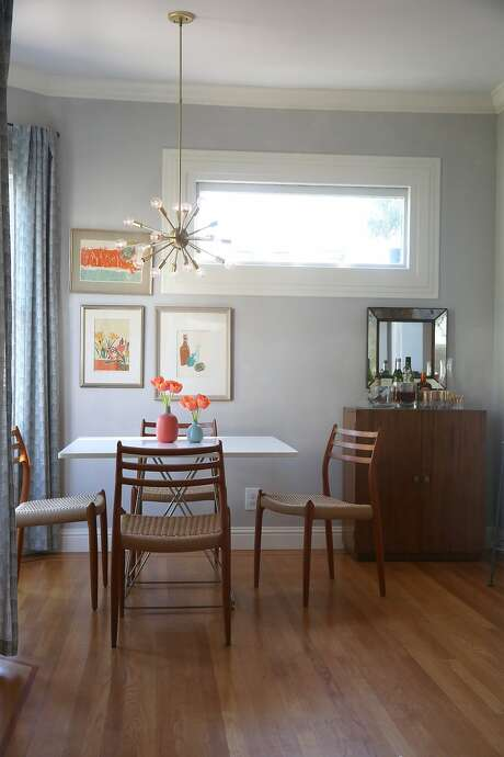 Interior designer Jennifer Jones recognized the good bones of their 100-year-old home, and had the expertise to transform the space, including the dining area. Photo: Liz Hafalia, The Chronicle