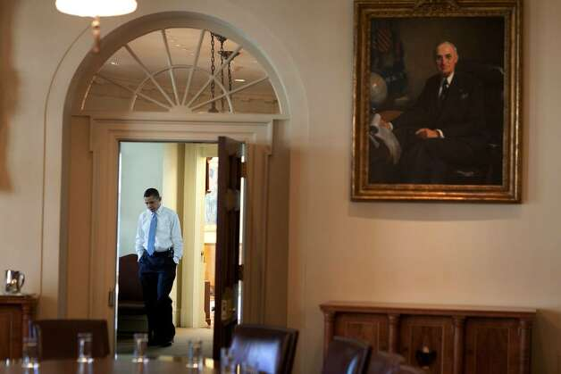 President Barack Obama Walks Through The Outer Oval Office