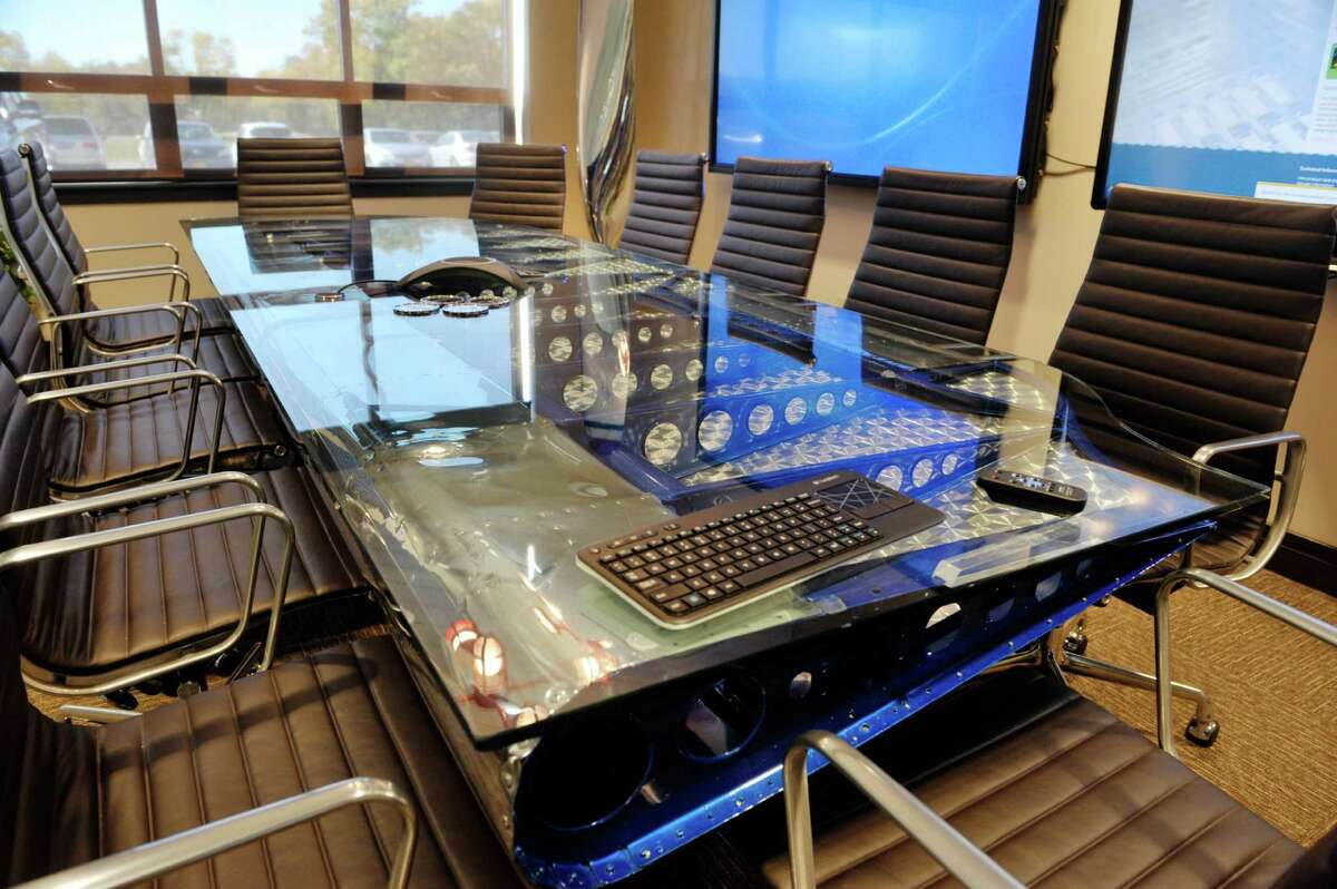 The conference room table is made from an elevator off the tail of a 1942 C-47 airplane at IntegraOptics on Thursday, Oct. 8, 2015, in Latham, N.Y. (Paul Buckowski / Times Union)