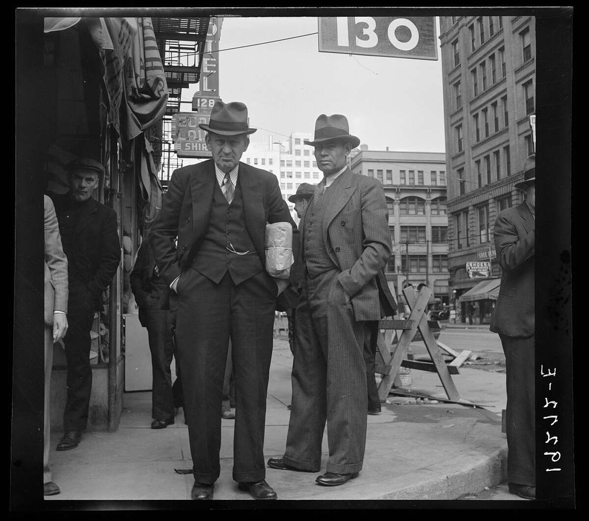 """""""Salvation Army, San Francisco, California. Men pause a moment to watch, and then pass on."""" April 1939"""