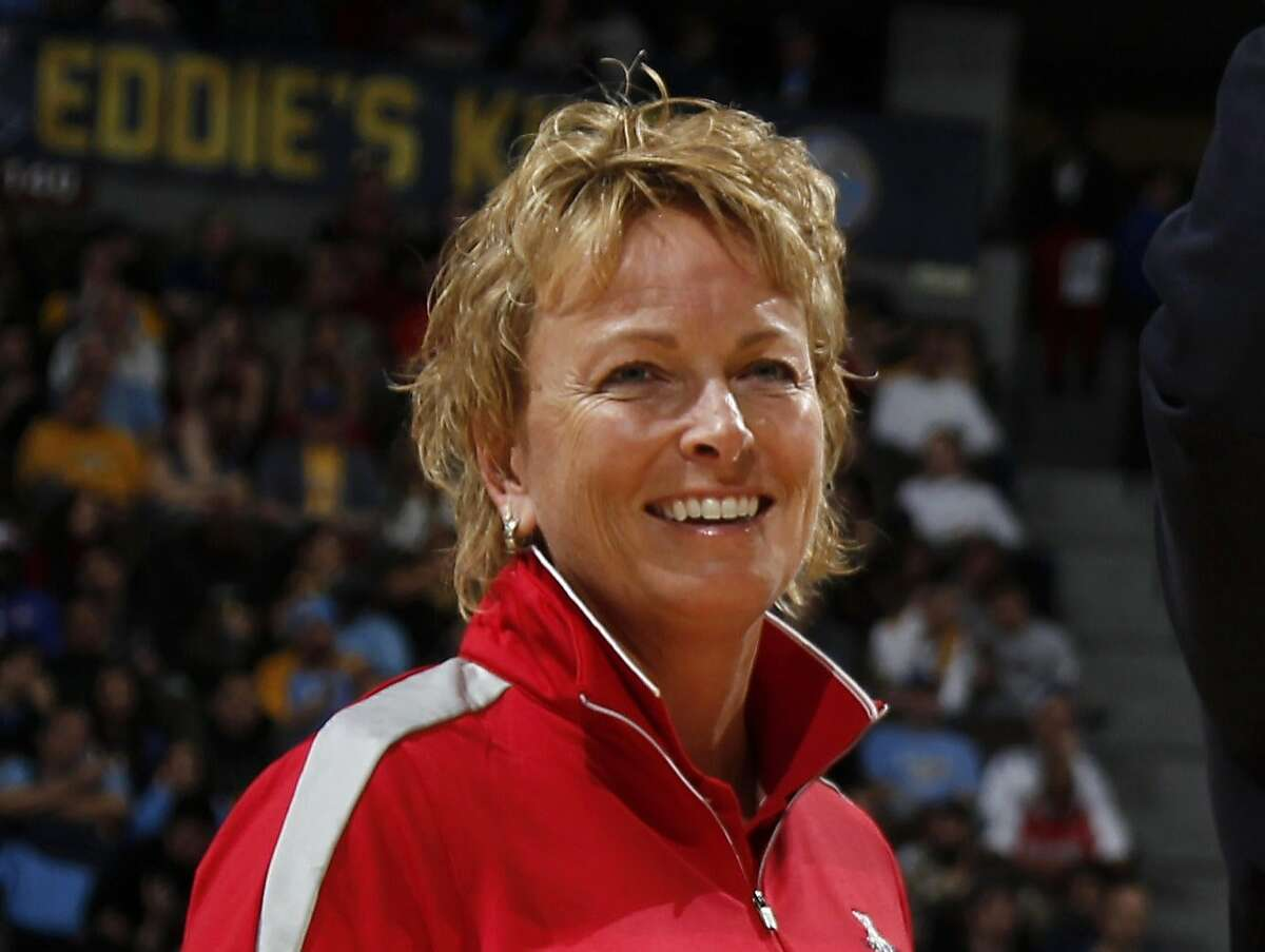 FILE - In this Feb. 7, 2013, file photo, Solheim Cup assistant captain Dottie Pepper smiles at an NBA game in Denver. Pepper has joined the CBS Sports golf broadcasting team and will return to full-time work. (AP Photo/David Zalubowski, File)