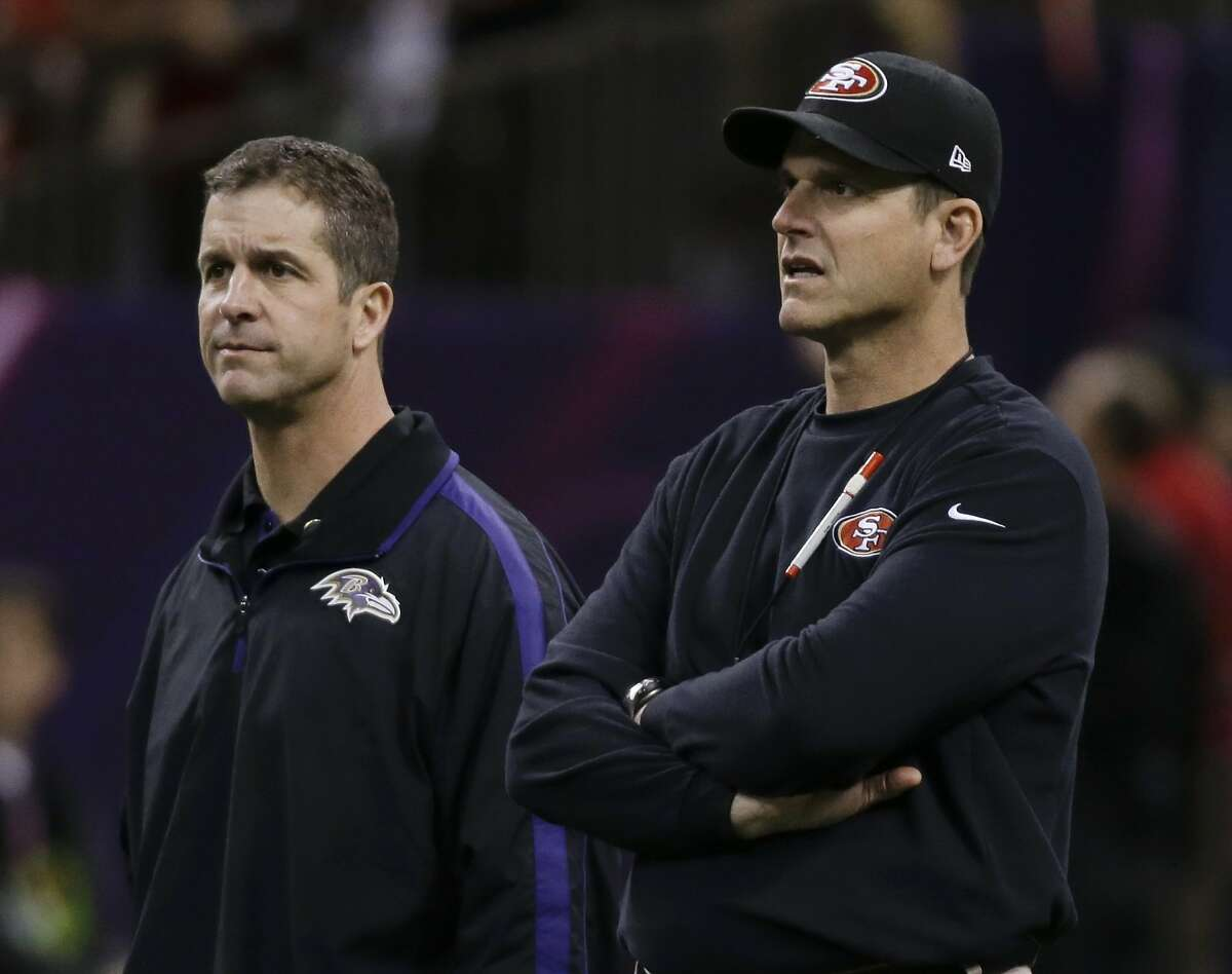 FILE - In this Feb. 3, 2013, file photo, San Francisco 49ers coach Jim Harbaugh, right, and Baltimore Ravens coach John Harbaugh watch practice before the NFL Super Bowl XLVII football game between their teams in New Orleans. Jim Harbaugh and the 49ers will face John Harbaugh and the Ravens on Thursday, Aug. 7, 2014, in the preseason opener for both teams. After that, the teams will practice together on Saturday, Sunday and Monday. (AP Photo/Matt Slocum, File)