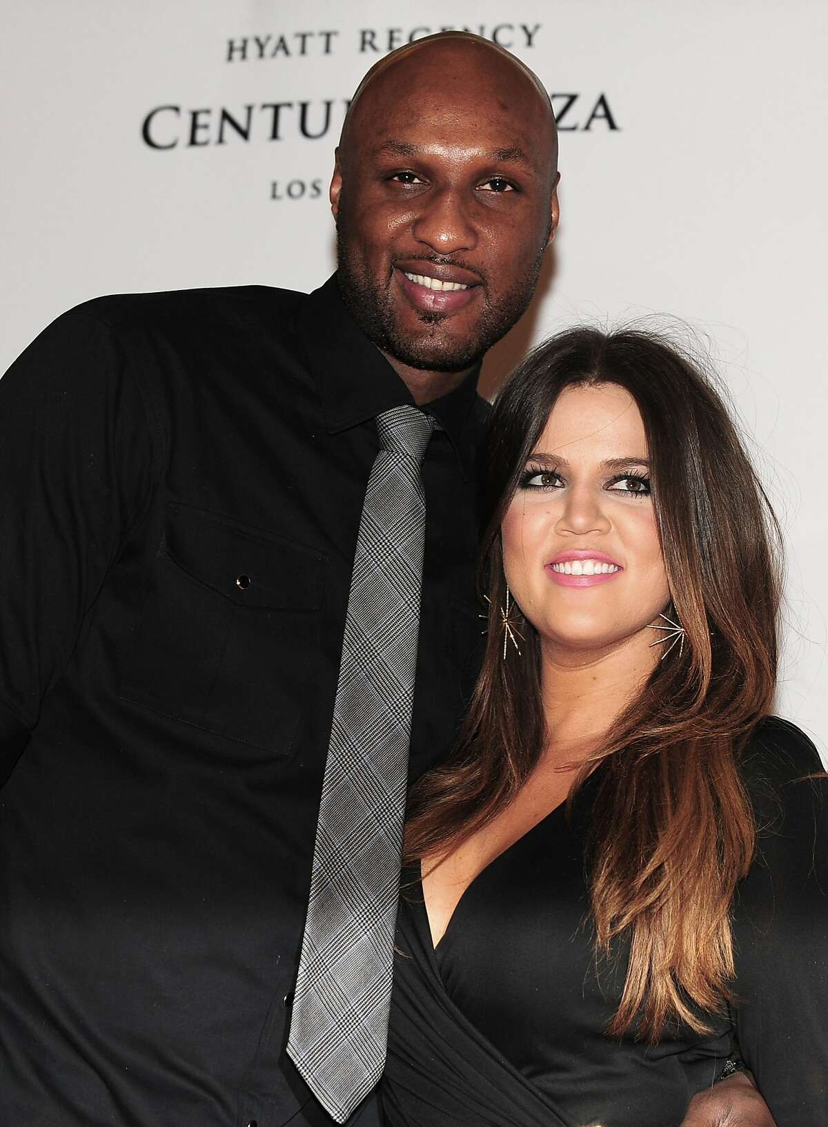 """(FILES) Lamar Odom and Khloe Kardashian-Odom pose on arrival for the 19th Annual Race to Erase MS themed """"Glam Rock to Erase MS"""" in Los Angeles in this May 18, 2012, file photo. Odom, a former NBA champion who gained wider fame as the husband of reality TV star Khloe Kardashian was in hospital after being found """"unresponsive"""" at a Nevada brothel, authorities said on October 13, 2015. The Nye County Sheriff's Department was called Tuesday afternoon to Love Ranch, a legal brothel in Crystal, Nevada, for a report of an """"unresponsive"""" man needing an ambulance, Sheriff Sharon A. Wehrly said in a statement. AFP PHOTO/Frederic J. BROWN/FILESFREDERIC J. BROWN/AFP/Getty Images"""