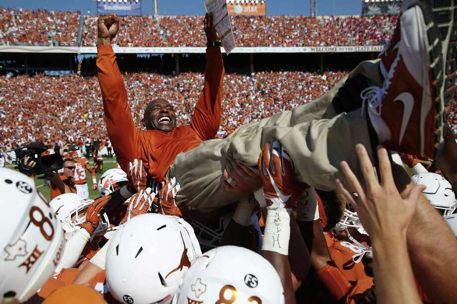 Texas head coach Charlie Strong is lifted by his players after their 24-17 win over Oklahoma on Oct. 10, 2015, in Dallas. Photo: Andy Jacobsohn / Dallas Morning News / The Dallas Morning News