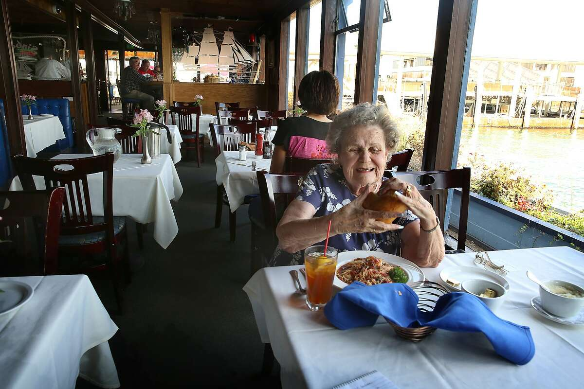 Helen Hayes enjoys some sourdough bread at Sinbad's in San Francisco, Calif., on Wednesday, October 14, 2015. This is her first visit for at least a decade. She used to work across the street at Southern Pacific for about fourty years and frequented Sinbad's after work during that time.