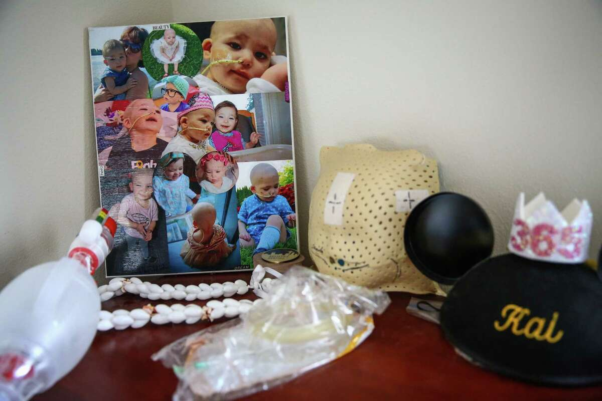 Photos of 3-year-old Kai Victoria are shown on a dresser at their northeast Seattle home on Tuesday.