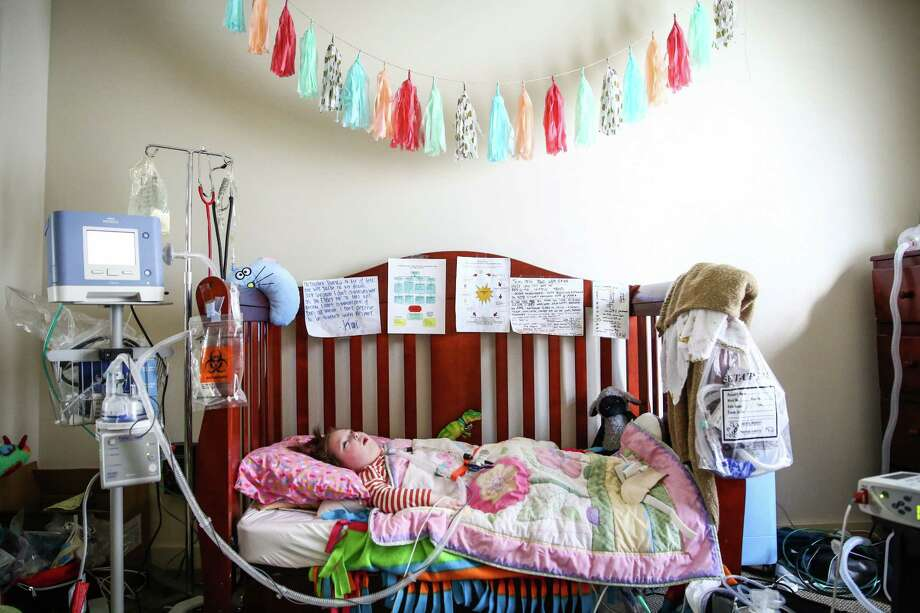 Kai Victoria, 3, rests in the bedroom of her northeast Seattle home on Tuesday, October 13, 2015. Kai is on a ventilator and is cared for around the clock at home by her mother and a team of nurses. She is one of four Washington children involved in a lawsuit meant to force the state to provide better, less-expensive care to ventilator-dependent kids. Photo: JOSHUA TRUJILLO, SEATTLEPI.COM / SEATTLEPI.COM