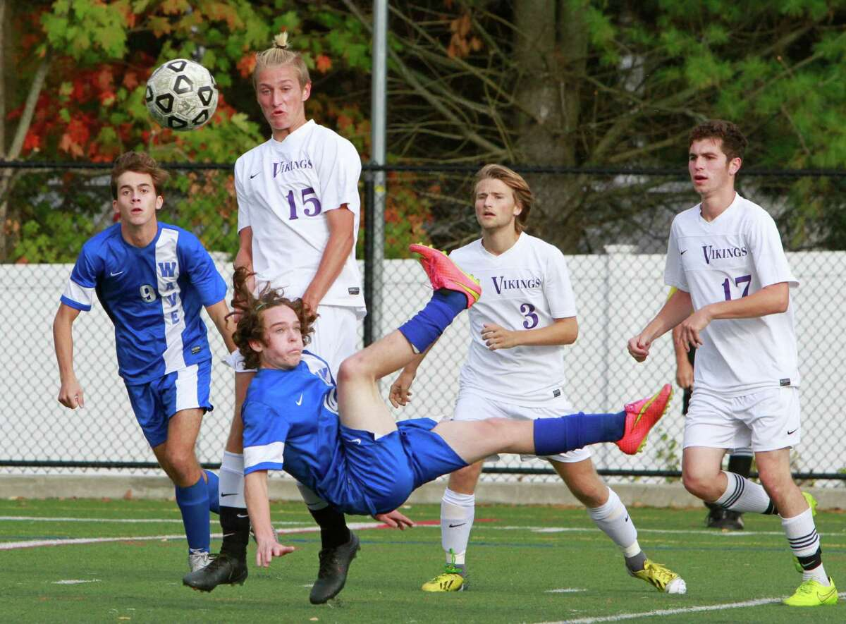Darien's Seth Canaday makes a sweeping back kick towards Westhill's goal. Darien defeated Westhill 3-2 in a varsity boys soccer match on Oct.14, 2015 in Stamford.