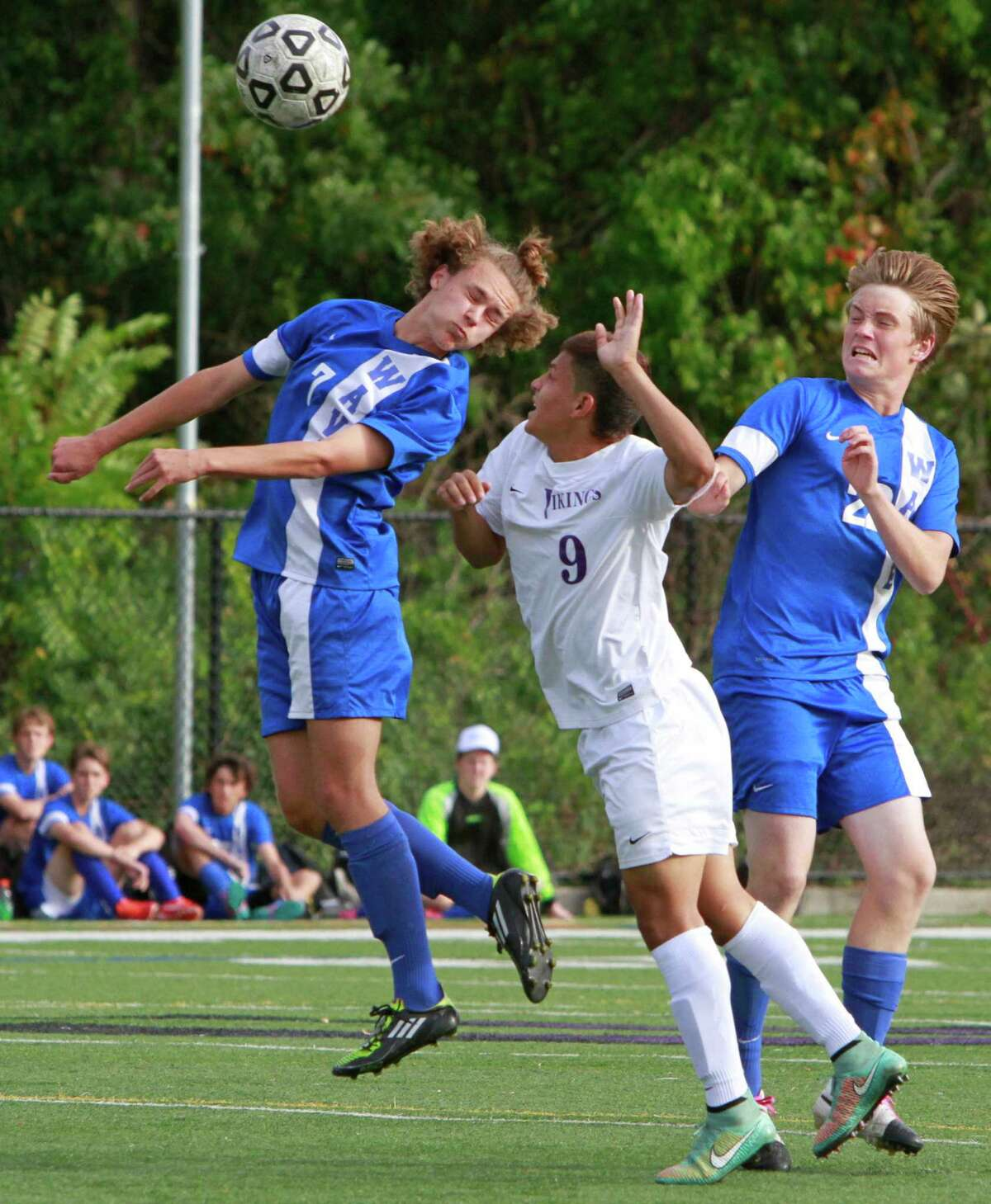 Darien's Tore Erikisen and Pater Case battle with Jairo David Garcia for the ball at midfield. Darien defeated Westhill 3-2 in a varsity boys soccer match on Oct.14, 2015 in Stamford.