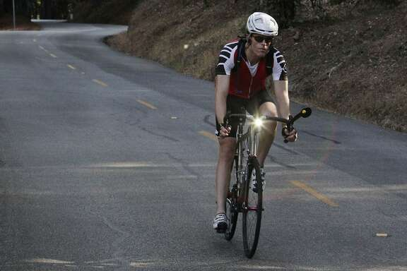 A bicyclist makes their way down Kings Mountain Road on  Wednesday, October 14,  2015 in San Mateo County.