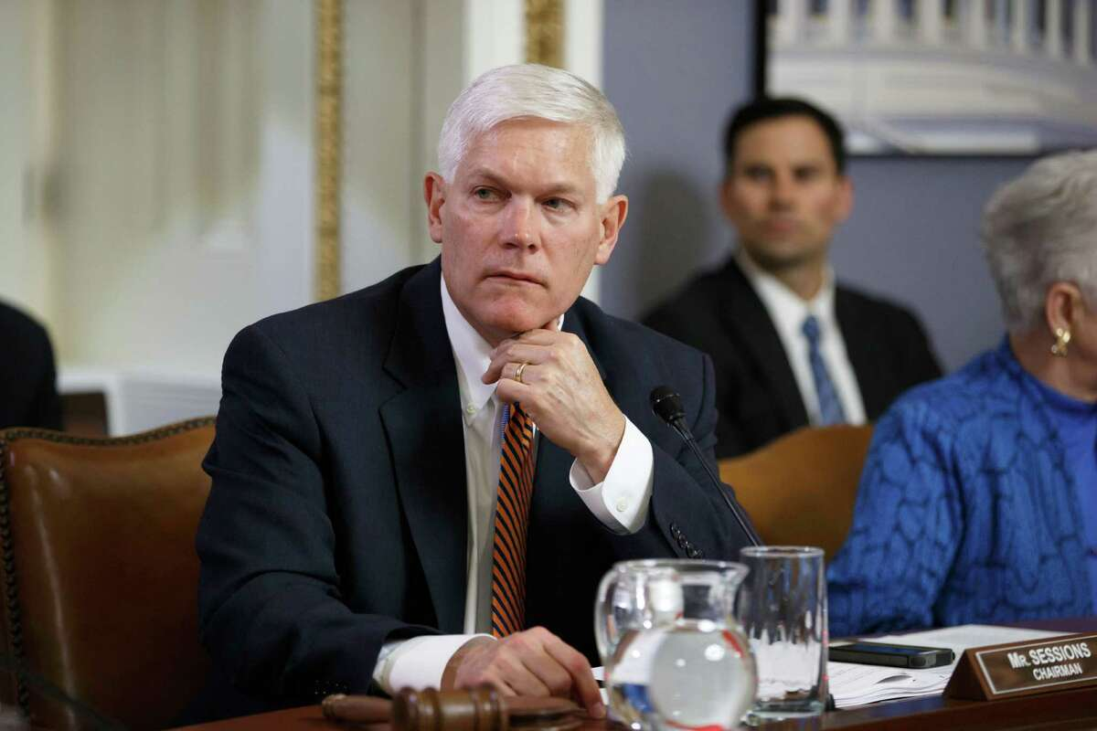House Rules Committee Chairman Pete Sessions, R-Texas, works on the creation of a special select committee to investigate the attack on the U.S. diplomatic outpost in Benghazi, Libya, at the Capitol in Washington, Wednesday, May 7, 2014. Anticipating a swift shake-up in their leadership, House Republicans, including Sessions, jockeyed for position on Wednesday after Majority Leader Eric Cantor's stunning primary defeat to an underfunded and unknown political newcomer in the Virginia primary. Sessions, who spent four years as chairman of the National Republican Congressional Committee, has made clear that he will seek to replace Cantor, possibly setting up a challenge to Rep. Kevin McCarthy of California, the party whip and third-ranking leader. (AP Photo/J. Scott Applewhite)