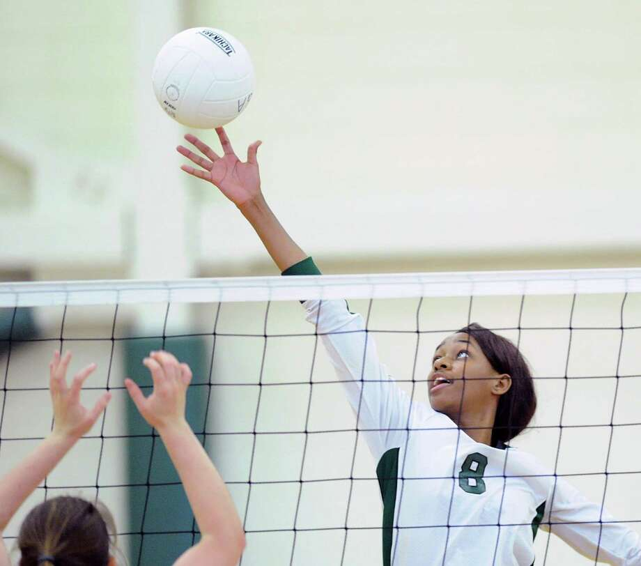 Convent's  Marie Njie-Mitchell (#8) tips the ball over the net during the girls high school volleyball match between Convent of the Sacred Heart and Greenwich Academy at Greenwich Academy, Conn., Wednesday, Oct. 14, 2015. Photo: Bob Luckey Jr. / Hearst Connecticut Media / Greenwich Time