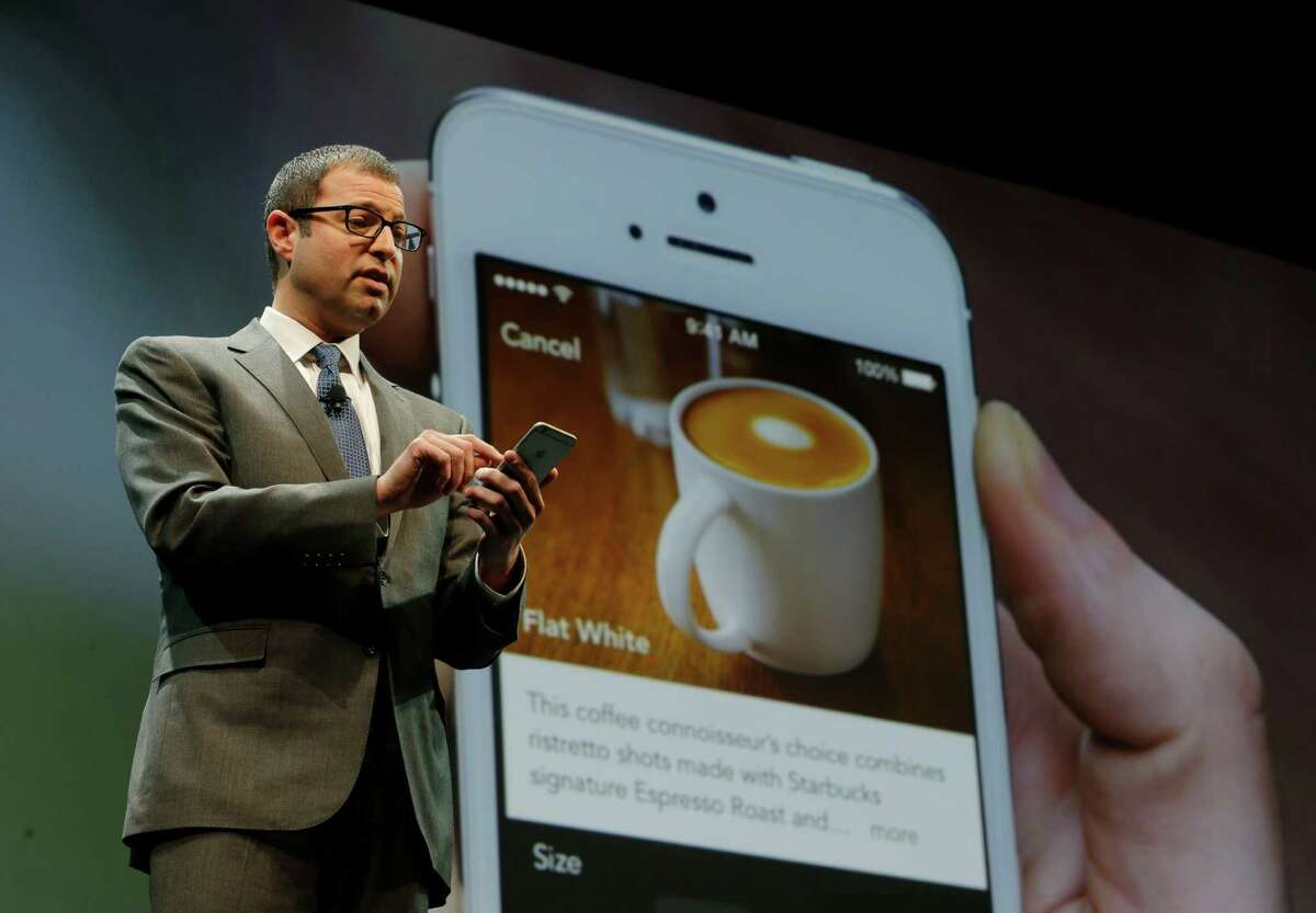 Adam Brotman, Starbucks chief digital officer, talks about the company's new mobile ordering app at Starbucks Coffee Co.'s annual shareholders meeting in Seattle. The app became available nationally last month.
