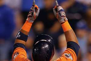 Houston Astros third baseman Luis Valbuena points skyward after hitting a 2-run home run off Kansas City Royals starting pitcher Johnny Cueto during the second inning of Game 5 of the American League Division Series at Kauffman Stadium on Wednesday, Oct. 14, 2015, in Kansas City.