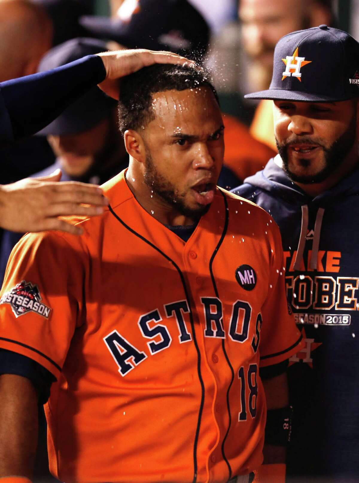 Houston Astros third baseman Luis Valbuena is splashed with water in the dugout after hitting a 2-run home run off Kansas City Royals starting pitcher Johnny Cueto during the second inning of Game 5 of the American League Division Series at Kauffman Stadium on Wednesday, Oct. 14, 2015, in Kansas City.