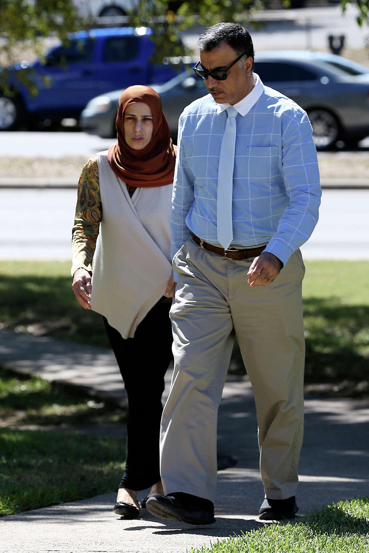 Qatar official Hassan Al Homoud and his wife, Zainab Al Hosani walk into Federal Court, Wednesday, Oct. 14, 2015.