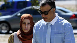 Qatar official Hassan Al Homoud and his wife, Zainab Al Hosani walk into Federal Court, Wednesday, Oct. 14, 2015. They are facing federal charges of forced labor. They are accused of keeping a female servant and a housemaid under inhumane conditions and not paying them a salary. The two women, one from Indonesia and the other from Bangladesh, arrived in San Antonio in June of 2014 from Qatar. They were each promised a monthly salary of $1,573.87.