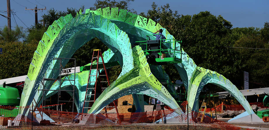 Randy Domeck of Indianapolis Fabrications assembles aluminum pieces of an art object Tuesday October 13, 2015 currently being constructed near Woodlawn Lake Park at the corner of South Josephine Tobin and Cincinatti. Designed by architect and artist Marc Fornes of the New York based studio THEVERYMANY, the canopy structure is composed of 1,000 pieces and 20,000 rivets according to Lance Pruitt of Indianapolis Fabrications. Pruitt said assembly of the mechanical structure should be completed by this Thursday. Photo: John Davenport, San Antonio Express-News / ©San Antonio Express-News/John Davenport