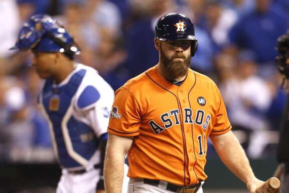 Houston Astros designated hitter Evan Gattis (11) walks out of the batters box after he was struck out by Kansas City Royals starting pitcher Johnny Cueto during the fifth inning of Game 5 of the American League Division Series at Kauffman Stadium on Wednesday, Oct. 14, 2015, in Kansas City. ( Karen Warren / Houston Chronicle )