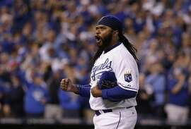 Kansas City Royals starting pitcher Johnny Cueto reacts as he walks off the field after pitching in the eighth inning of Game 5 in baseball's American League Division Series against the Houston Astros, Wednesday, Oct. 14, 2015, in Kansas City, Mo. (AP Photo/Charlie Riedel)