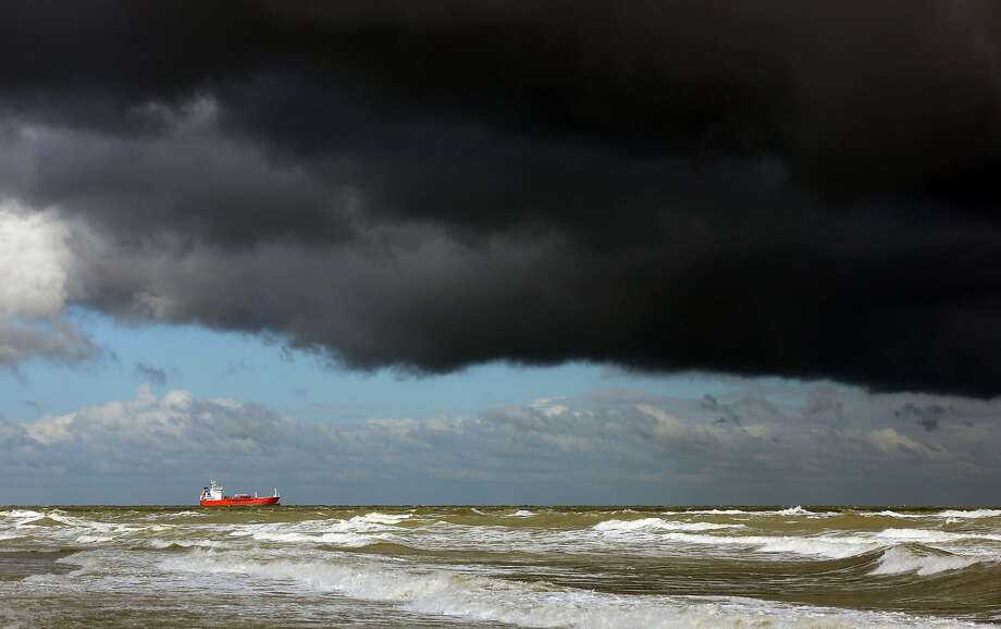 A ship is moored seeking shelter beneath stormy skies in the English Channel off the coast of Margate, south eastern England, Wednesday Oct. 14, 2015. Britain's weather is turning colder as autumnal storms head for the island. Photo: Gareth Fuller, Associated Press