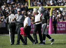 Oakland Raiders defensive end Justin Tuck (91) walks off the field during the second half of an NFL football game against the Denver Broncos in Oakland, Calif., Sunday, Oct. 11, 2015. (AP Photo/Marcio Jose Sanchez)
