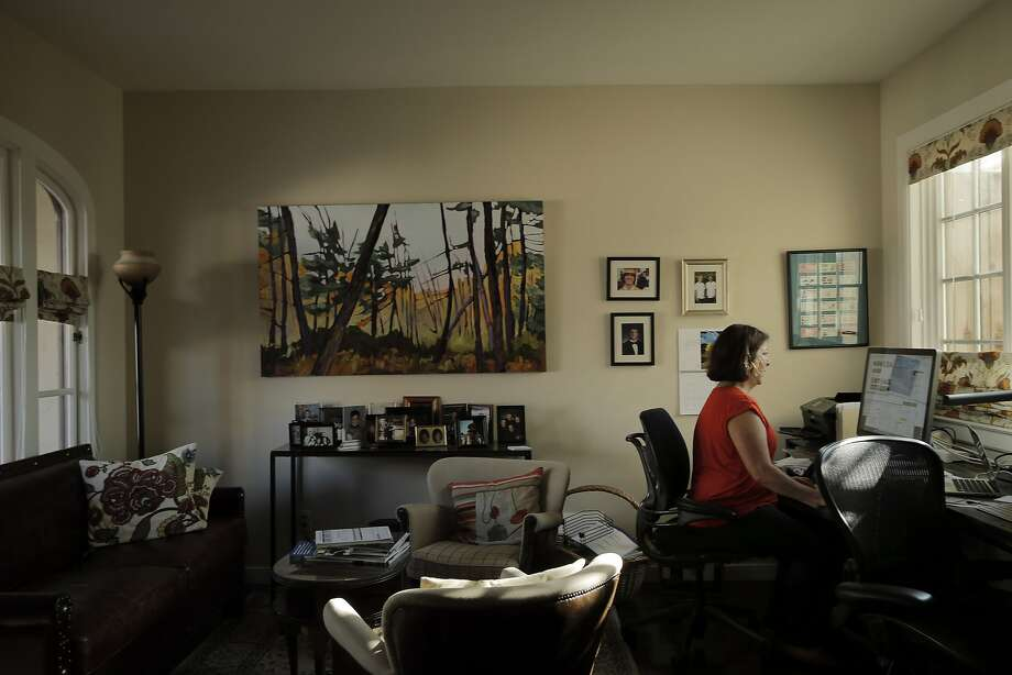 Fran Maier waits in her office for Airbnb renter Emily Robin to arrive at her Potrero Hill home in San Francisco. Maier rents out rooms in her home on Airbnb and says the extra income pays for the home, upkeep and allows her to devote her time to volunteer causes. Photo: Carlos Avila Gonzalez, The Chronicle