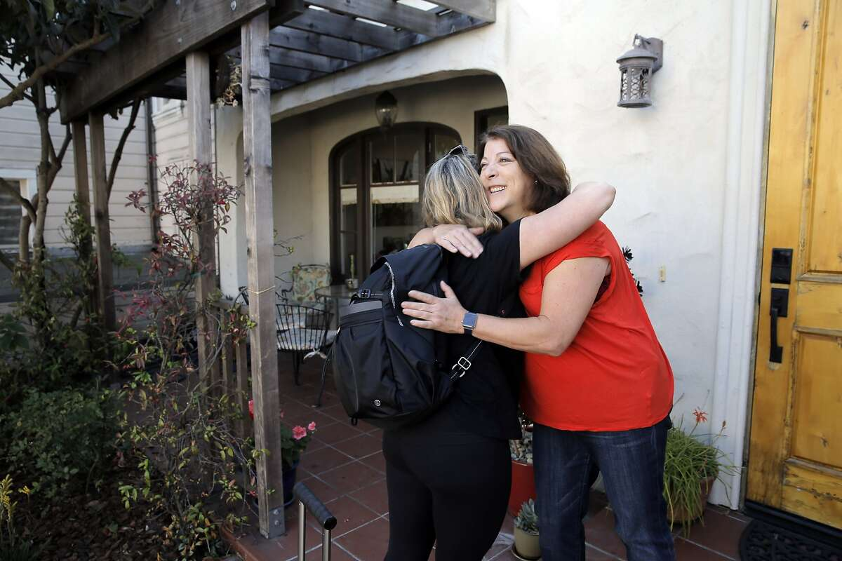 Fran Maier, right, greets Airbnb renter Emily Robin of Vancouver, left, in her Potrero Hill home in San Francisco, Calif., on Wednesday, October 14, 2015. Maier rents out rooms in her home on Airbnb and says the extra income pays for the home, upkeep and allows her to devote her time to volunteer causes. She says Proposition F would severely limit her ability to maintain her home would take away her quality of life.