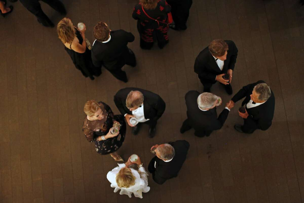 Attendees chat during cocktail hour during 10th anniversary gala at de Young Museum in San Francisco, Calif., on Wednesday, October 14, 2015.
