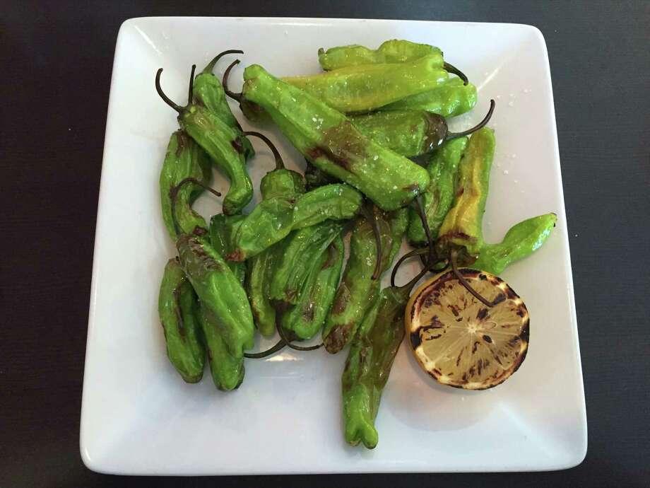Roasted shishito peppers at Embers Photo: Edmund Tijerina / San Antonio Express-News