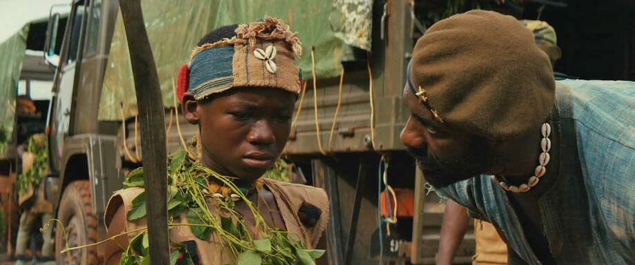 "Idris Elba and Abraham Attah in the Netflix original film ""Beasts of No Nation."" (Netflix) Photo: Netflix, HO / McClatchy-Tribune News Service / Chicago Tribune"