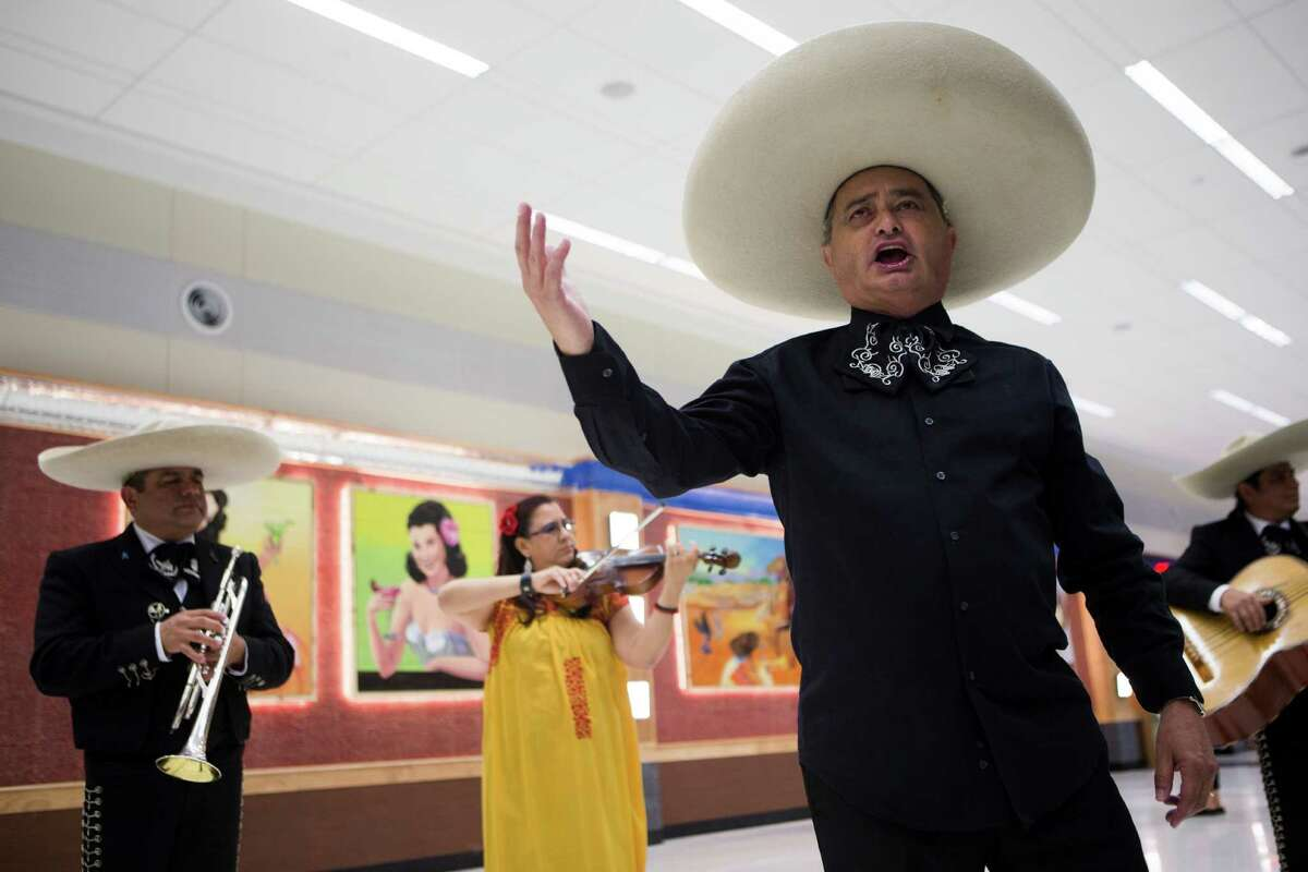 Alfredo Espinosa sings with the Mariachi Los Gallitos during the inauguration of the Southwest Airlines' international concourse at Hobby Airport, Thursday, Oct. 15, 2015, in Houston.