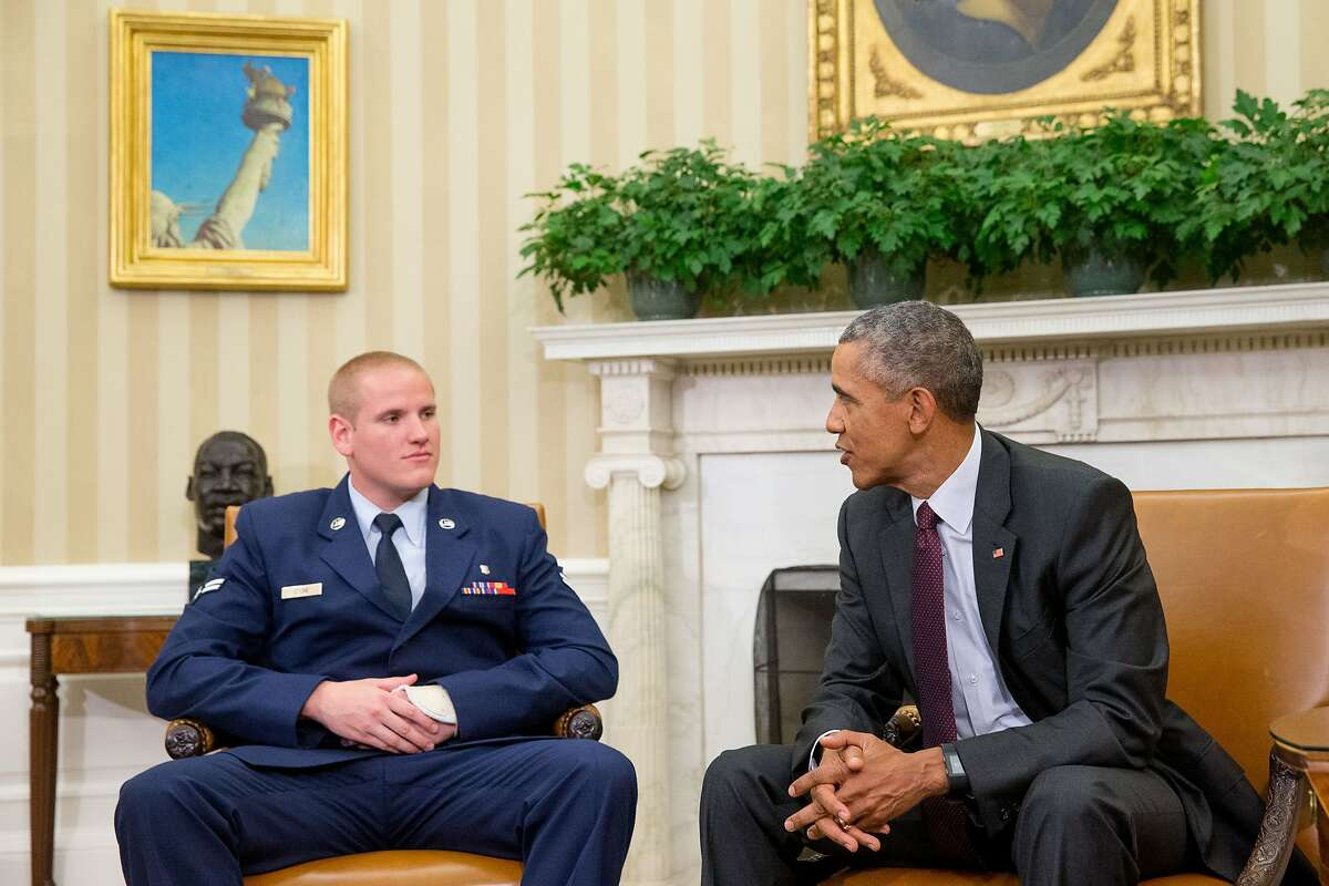 In this Sept. 17, 2015 file photo, President Barack Obama speaks to Air Force Airman 1st Class Spencer Stone in the Oval Office of the White House in Washington. An Air Force spokesman says Stone, who helped subdue an attacker on a French train in August, is in stable condition after being stabbed in California. (AP Photo/Andrew Harnik, File)