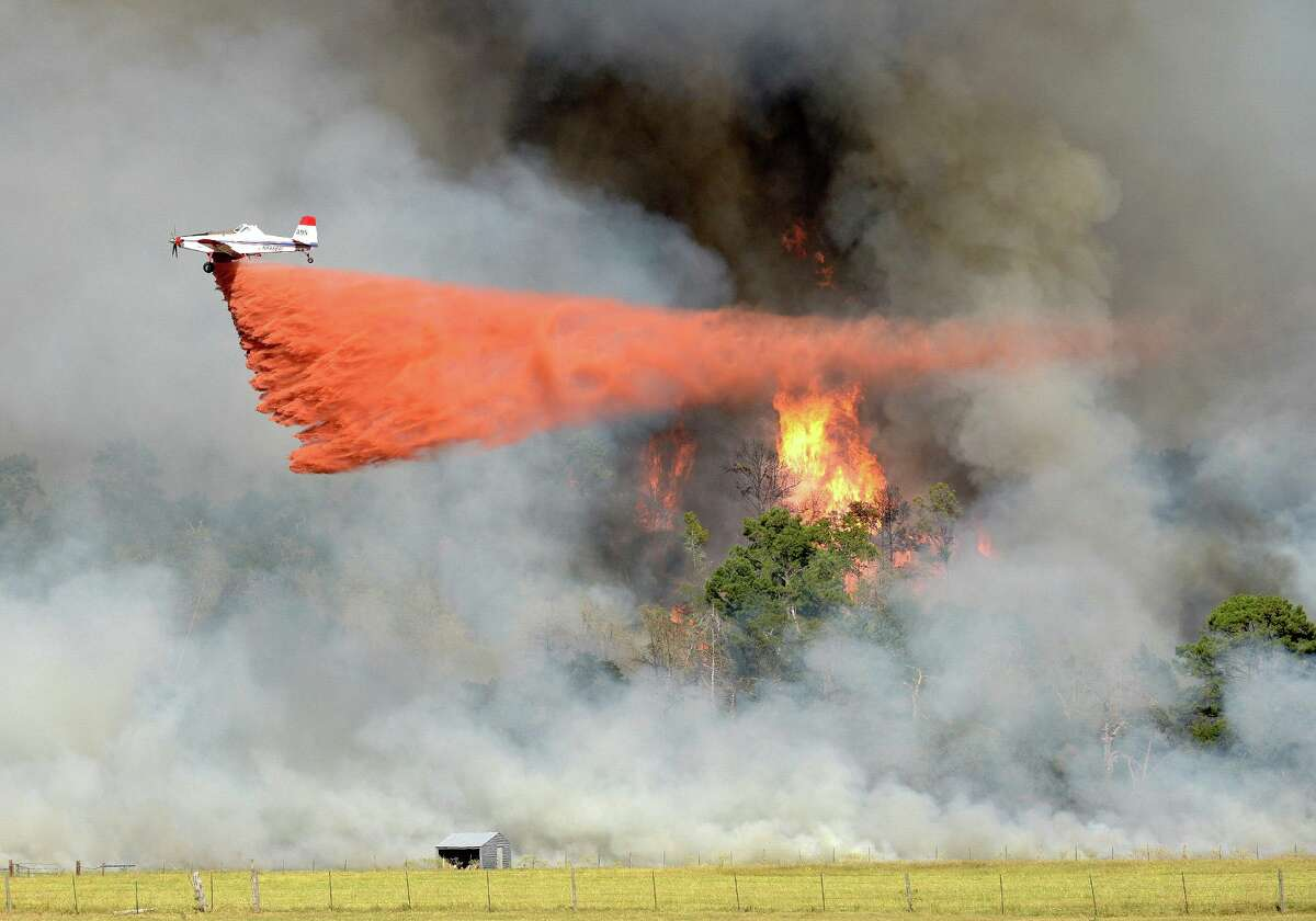 Fire fighting aircraft release a mixture of water with ammonium phosphate or sulfate at the Lonesome Pines Ranch located just north of Buescher State Park. The mixture is more of a fire retardant than a fire extinguisher.