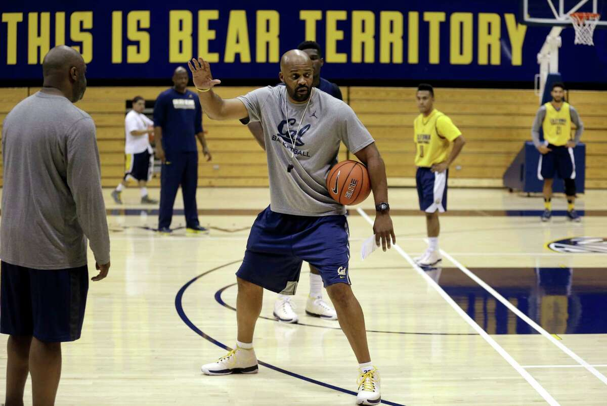 California mens basketball coach Cuonzo Martin, center, gestures during basketball practice Wednesday, Oct. 7, 2015, in Berkeley, Calif. (AP Photo/Ben Margot)