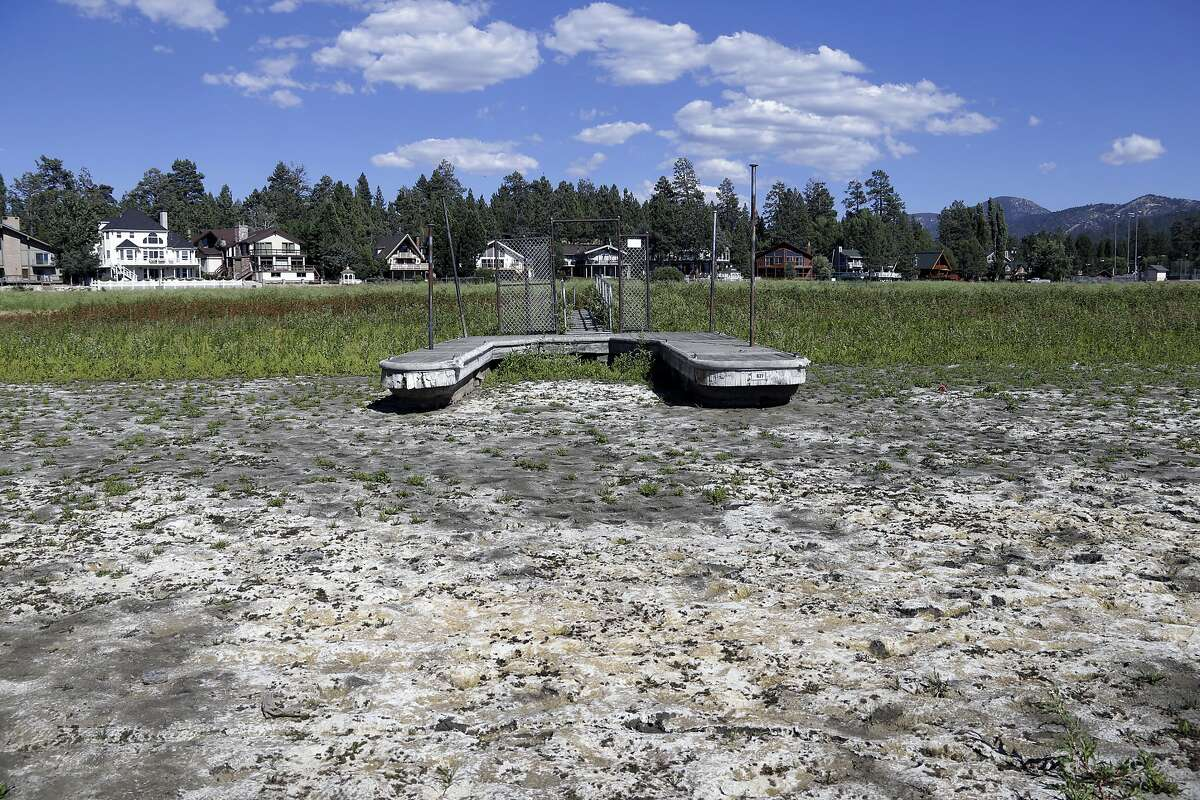This file photo, shows a boat dock by the lake bed where water has dried due to the drought at Big Bear Lake, Calif.