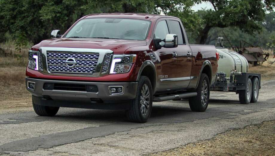 nissan titillates with new diesel titan takes home truck of texas title houston chronicle. Black Bedroom Furniture Sets. Home Design Ideas