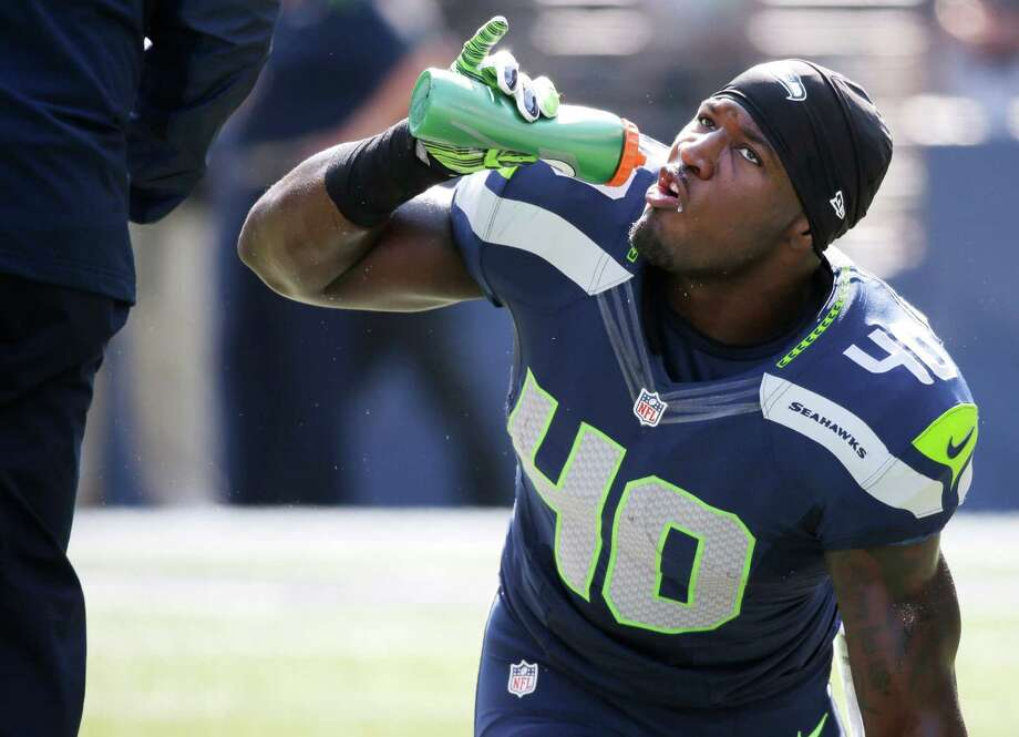 Seattle Seahawks' Derrick Coleman sips water before an NFL football game against the Denver Broncos, Sunday, Sept. 21, 2014, in Seattle. (AP Photo/Elaine Thompson) Photo: Elaine Thompson, Associated Press / AP