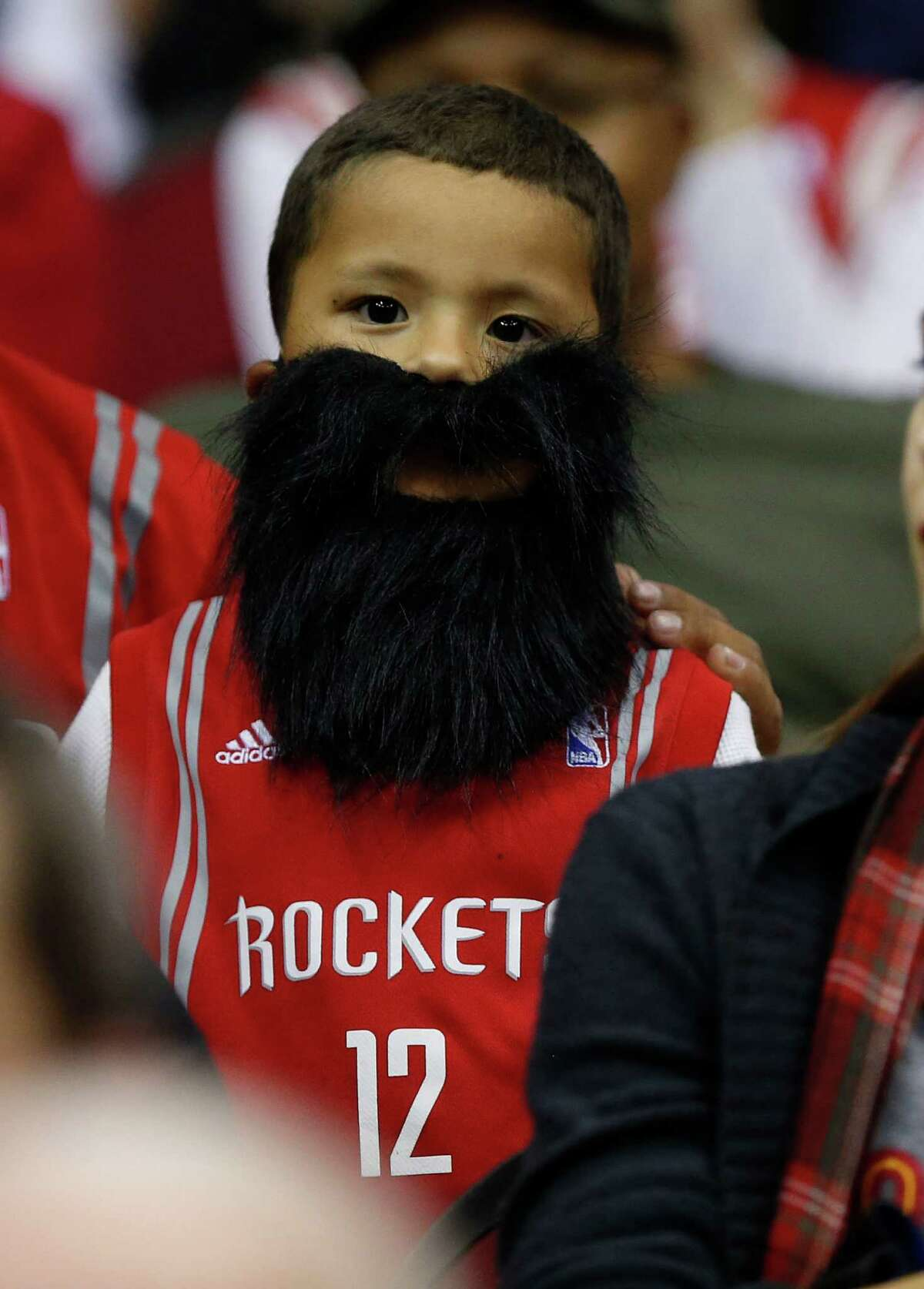 Diego Castaneda, 5, wears a beard in his seats before the start of an NBA basketball game at Toyota Center, Saturday, Nov. 1, 2014, in Houston. ( Karen Warren / Houston Chronicle )