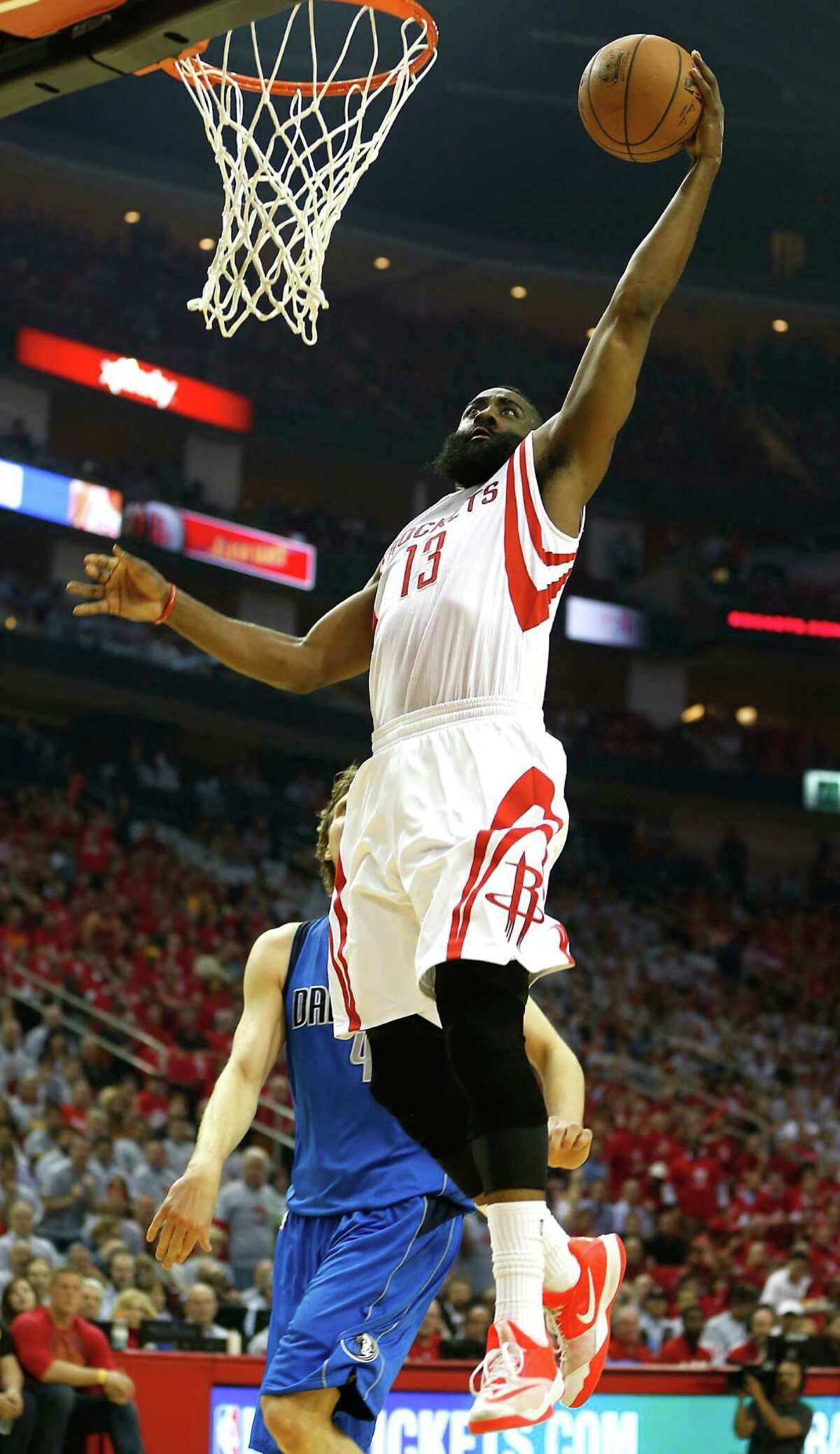 Houston Rockets guard James Harden heads to the basket during the first half of Game 2 in the first round of NBA basketball playoffs against the Dallas Mavericks at the Toyota Center Tuesday, April 21, 2015, in Houston. ( James Nielsen / Houston Chronicle )