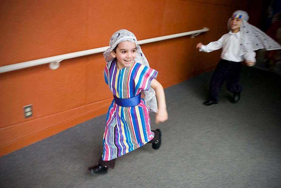Daniel Janush, 5, makes his way to the gymnasium to perform in the Passover play at the Bi-Cultural Day School in Stamford, Conn. on Friday, March 26, 2010. Photo: Kathleen O'Rourke / Stamford Advocate