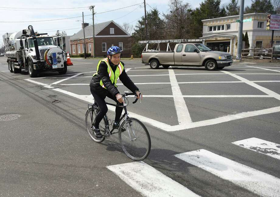 Stamford resident Jerry Silber, founder of People Friendly Stamford, rides his bike along High Ridge Road in Stamford, Conn. Monday, April 6, 2015.  People Friendly Stamford's mission is to connect Stamford's neighborhoods in a way that is safe for both cyclists and pedestrians, particularly by creating bike lanes throughout town. Photo: Tyler Sizemore / Tyler Sizemore / Greenwich Time