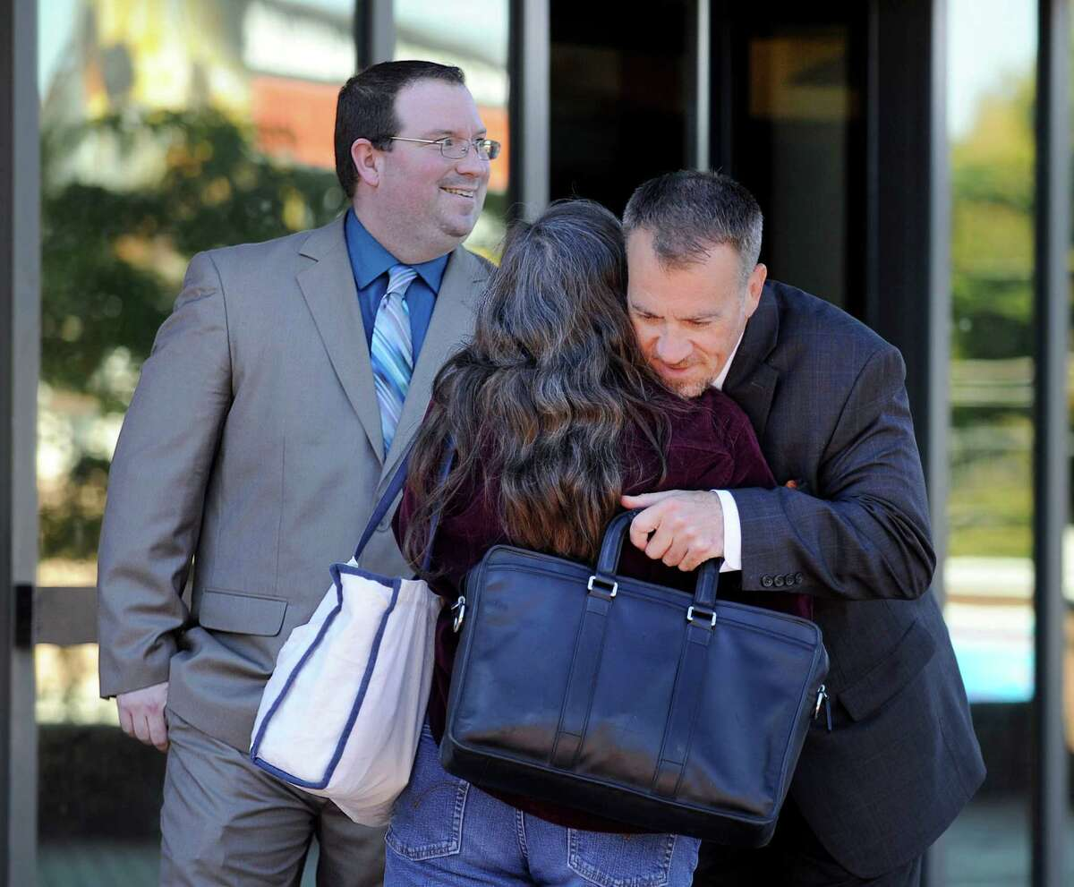 More than two years after then-Danbury police officer Christopher Belair, left, was accused of berating an undocumented immigrant and threatening to beat him during a traffic stop, a jury on Thursday found him not guilty, Thursday, Oct. 15, 2015 at the Superior Court in Danbury. Leaving court, his mother Stacey Belair is hugged by his attorney, Eugene Zingaro.